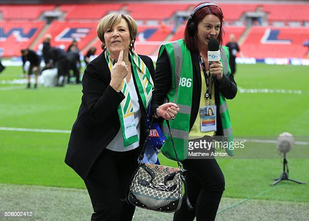 Delia Smith of Norwich City pulls a face whilst getting interviewed by Juliette Ferrington of BBC Radio Five Live Sport