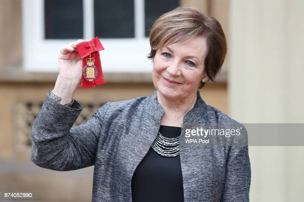 Delia Smith poses after she was made a member of the Order of the Companions of Honour by Queen Elizabeth II at Buckingham Palace on November 14,...
