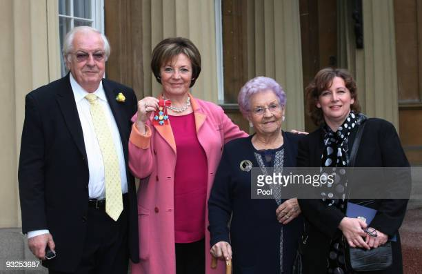 Delia Smith, with her husband Michael Wynn Jones, mother Etty Smith and manager Melanie Grocott, after receiving her Commander of the British Empire...