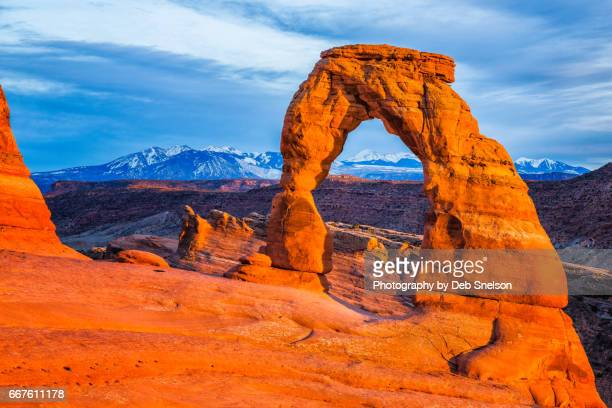 delicate arch glowing with last light of sunset - delicate arch stock pictures, royalty-free photos & images