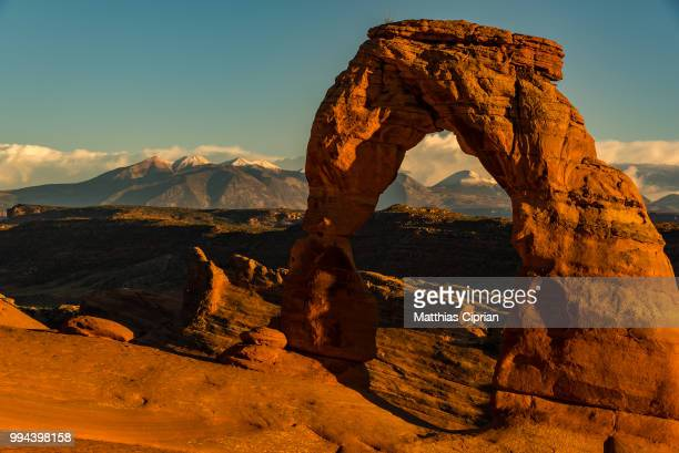 Delicate Arch in front of snowy La Sal Mountains