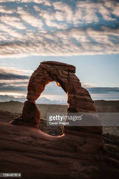 delicate arch near moab utah at sunrise arches national park - bedrock stock pictures, royalty-free photos & images