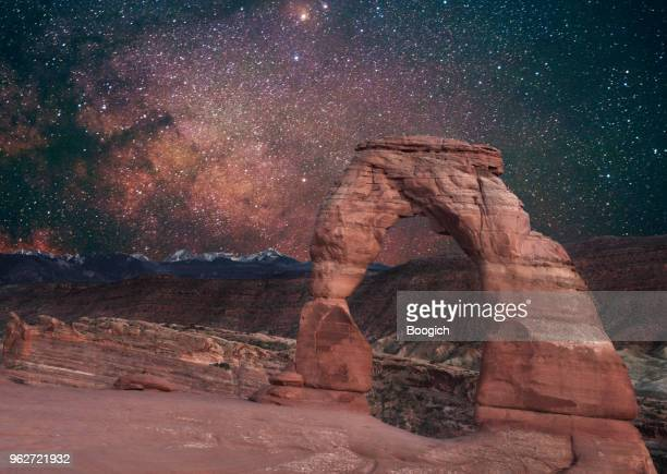 delicate arch with milky way arches national park utah night - delicate arch stock pictures, royalty-free photos & images