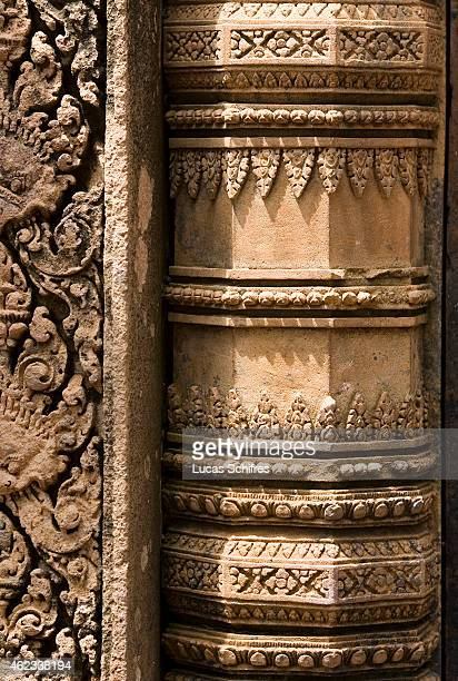 Delicate carvings on Banteay Srei temple on October 5 2009 in Angkor Cambodia Banteay Srei is a 10th century Cambodian temple built largely of red...