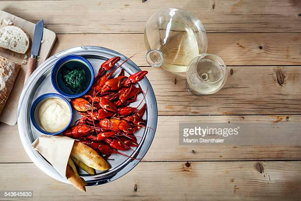 Delicate fresh Crawfish on wooden table
