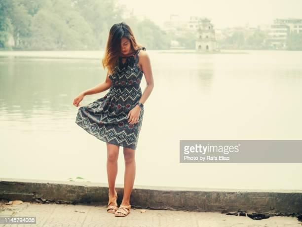 delicate lady standing by the lake - depilazione intima foto e immagini stock
