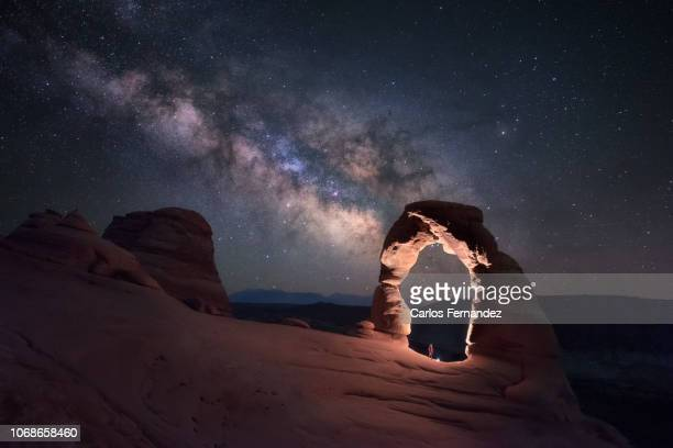 delicate milky way - delicate arch stock pictures, royalty-free photos & images
