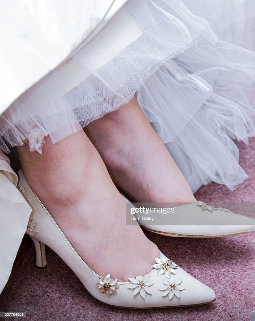 Delicate Off White Wedding Shoes Stock Photo