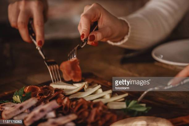 delicatessen and cheese served on the table - serrano ham stock photos and pictures