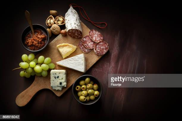 delicatessen: delicatessen variety still life - green olive stock photos and pictures