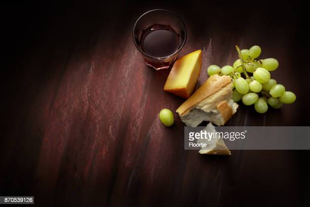 Delicatessen: Red Wine, Cheese, Grapes and Baguette Still Life