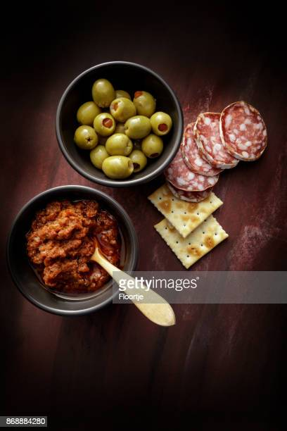delicatessen: tapenade, olives and sausage still life - antipasto stock pictures, royalty-free photos & images