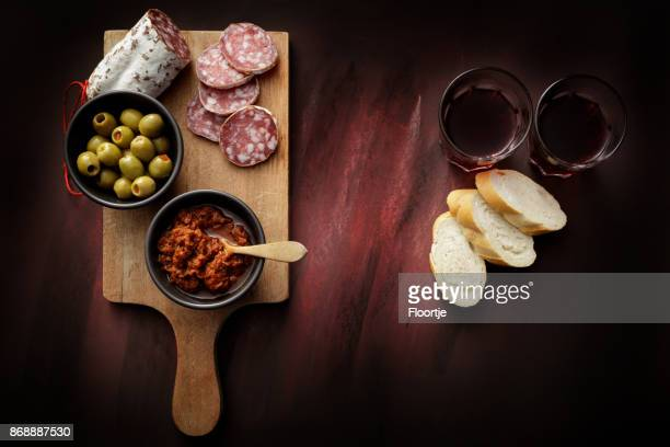 Delicatessen: Tapenade, Olives, Sausage and Wine Still Life