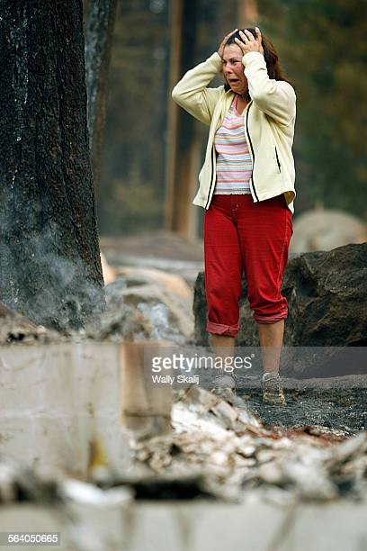 Delicia Spees cries as she looks at the remains of her burned home on Mt Diablo in South Lake Tahoe Monday