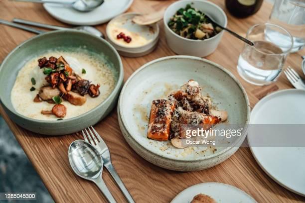 delicious and luxury vegetarian food freshly served on the dining table - gourmet eten stockfoto's en -beelden