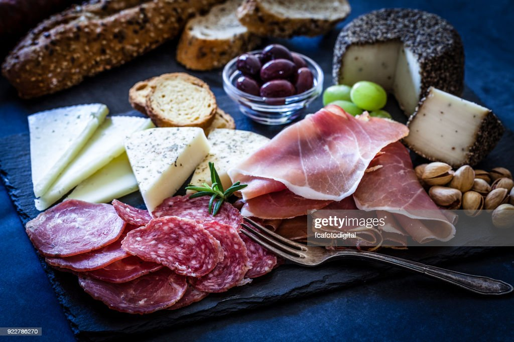 Delicious appetizer on bluish tint table : Stock Photo