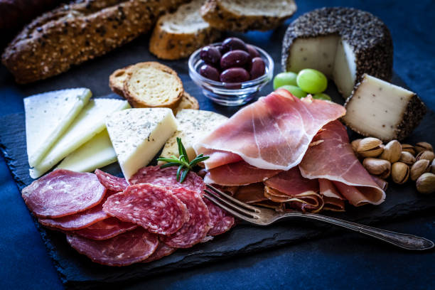 delicious appetizer on bluish tint table - salami bread and cheese stock pictures, royalty-free photos & images