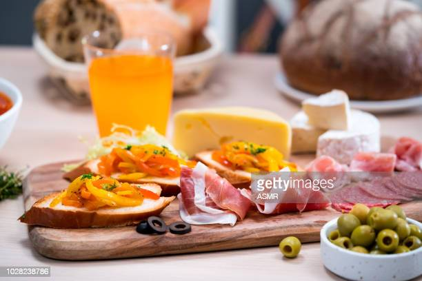 delicious appetizer on rustic wood table - salumeria stock photos and pictures