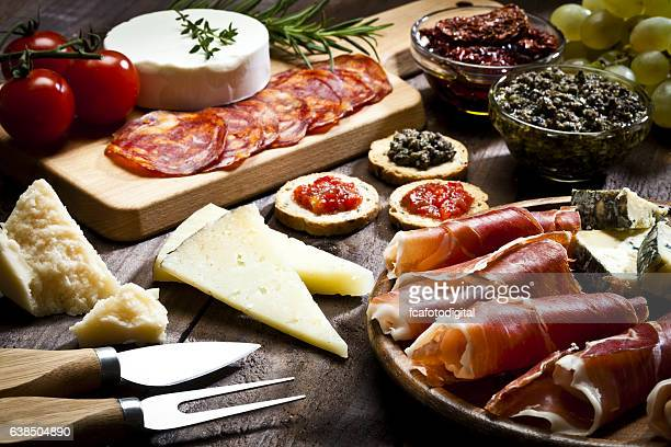 delicious appetizer on rustic wood table - delicatessen stock pictures, royalty-free photos & images