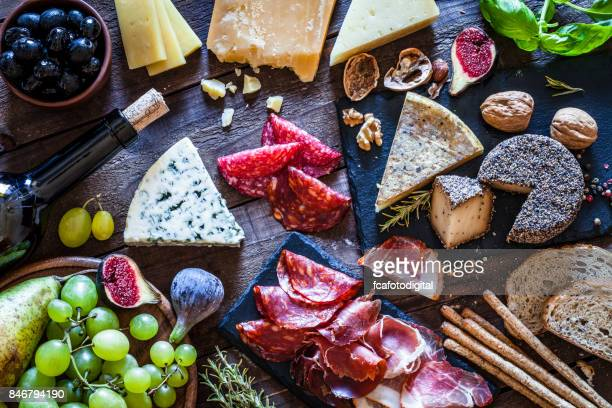 delicious appetizer on rustic wooden table - delicatessen stock pictures, royalty-free photos & images
