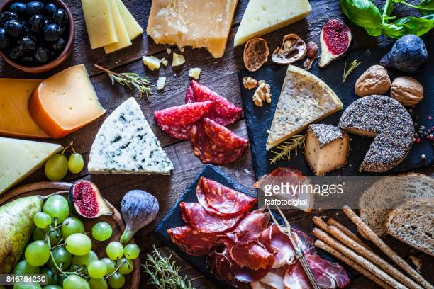 delicious appetizer on rustic wooden table - spanish culture stock photos and pictures