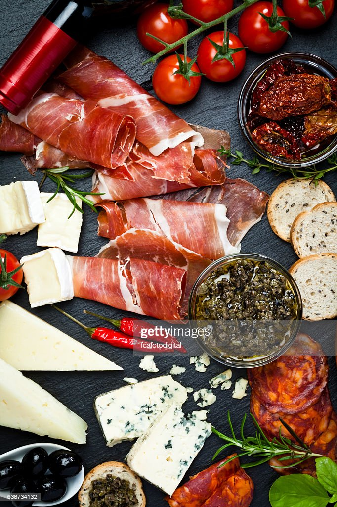 Delicious appetizers on dark slate table : Stockfoto