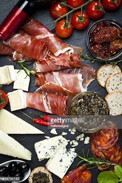 delicious appetizers on dark slate table - antipasto stock pictures, royalty-free photos & images