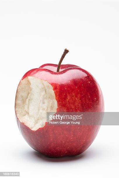A Delicious apple on white with a bite taken out