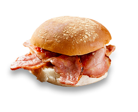 delicious bacon roll shot on white, and cut out with a drop shadow 975748916