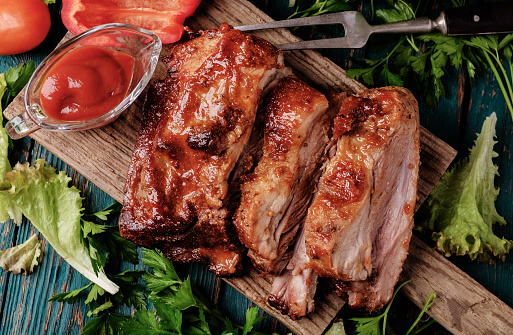 Delicious barbecued ribs seasoned with a spicy basting sauce 489251308