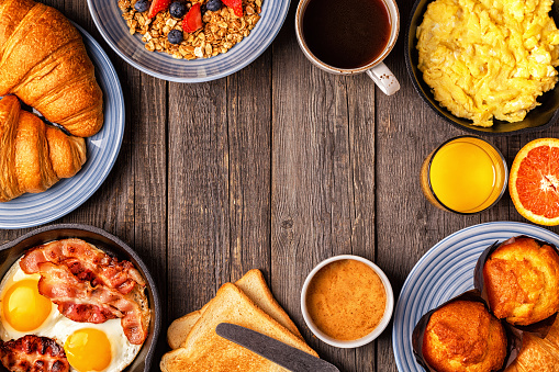 Delicious breakfast on a rustic table. 863444560