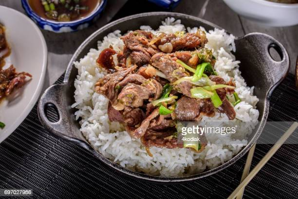Delicious Bulgogi , Marinated in soy sauce and garlic and ginger,over Steamed Rice