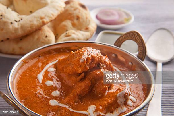 delicious butter chicken with tandoori rotis - butter chicken stock photos and pictures