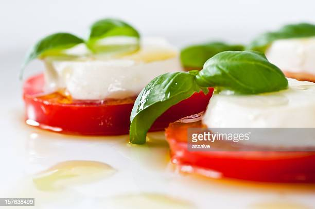 delicious caprese salad - mozzarella stock photos and pictures