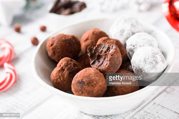 Delicious chocolate truffles and Christmas chocolate candies in bowl.