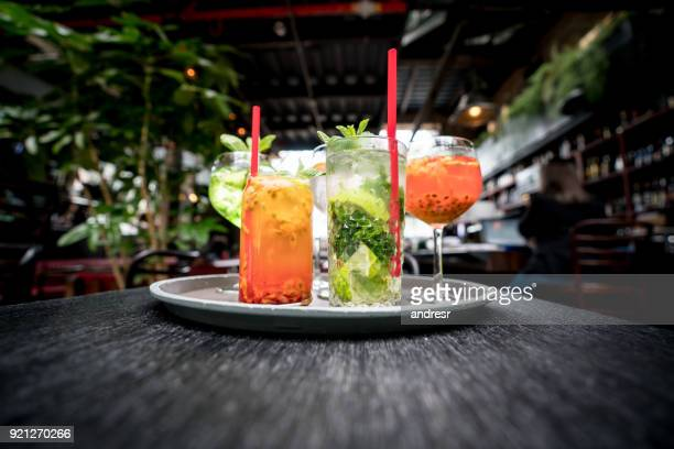 delicious cocktails served at a bar - cocktail party stock pictures, royalty-free photos & images