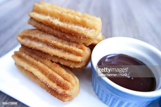 delicious food in plate - churro stock photos and pictures
