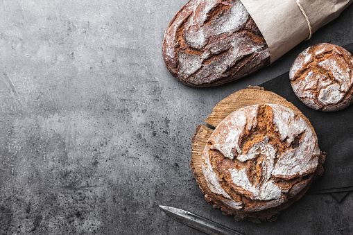 Delicious fresh bread on rustic background 819096148