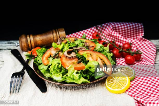 Delicious fresh salad and olive oil