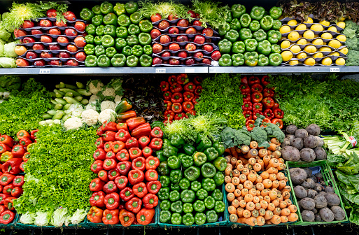 Delicious fresh vegetables and fruits at the refrigerated section of a supermarket 1172975655