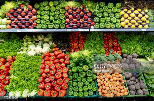 delicious fresh vegetables and fruits at the refrigerated section of a supermarket - fruit stock pictures, royalty-free photos & images