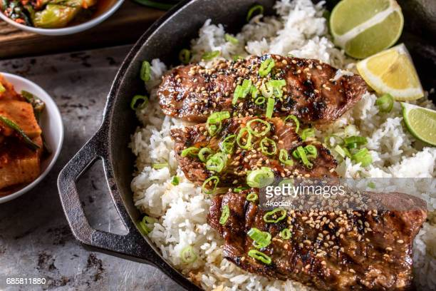 Delicious Grilled Kalbi on over Steamed Rice in Cast Iron Pan