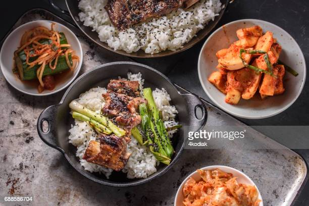 delicious grilled kalbi on over steamed rice in cast iron pan - korean culture stock pictures, royalty-free photos & images