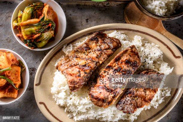 delicious grilled kalbi on over steamed rice - korean food stock pictures, royalty-free photos & images