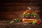 Delicious hamburger, served on wood.