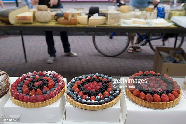 Delicious hand made cakes are displayed on a stall in Broadway Market in east London This street which was one of the oldest chartered markets in...