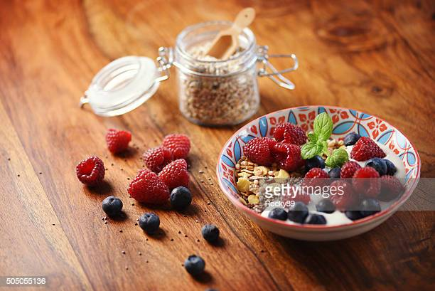 Delicious healthy breakfast with raspberries, blueberries, and a mint leaf