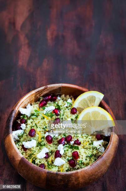 delicious healthy cous cous salad with herbs, lemon zest, feta cheese and pomegranate seeds - tabbouleh stock pictures, royalty-free photos & images