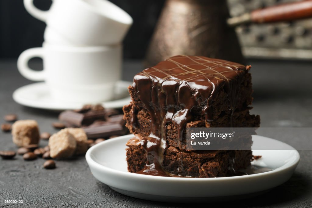 Delicious homemade brownie with chocolate sauce and caramel on the table. Selective focus : Stock Photo