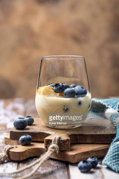 delicious homemade desert with ladyfingers cookies, fresh berries blueberry and custard cream layered in glass with mint, copy space - mascarpone cheese stock pictures, royalty-free photos & images